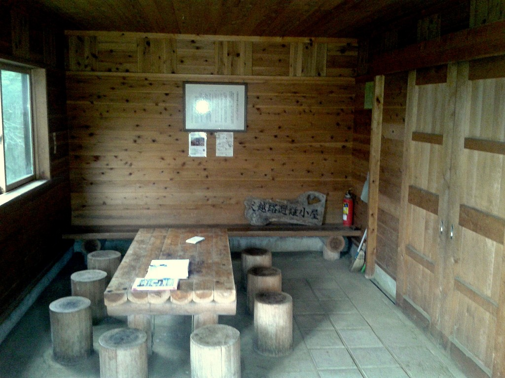 Japanese cedar table and the framed rules of the hut